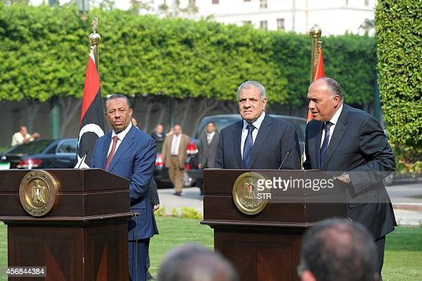 Egyptian Foreign Minister Sameh Shoukri and Prime Minister Ibrahim Mahlab take part in a press conference with Libyan Prime Minister Abdullah...