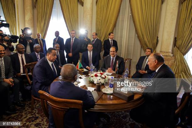 Egyptian Foreign Minister Sameh Shoukry and Egypt's interim intelligence chief MajorGeneral Abbas Kamel meet with their Sudanese counterparts Foreign...