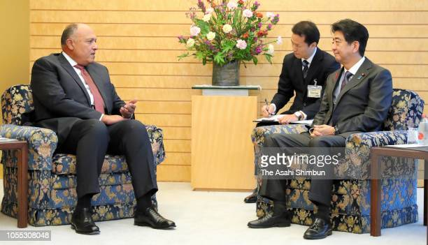 Egyptian Foreign Minister Sameh Shoukry and Japanese Prime Minister Shinzo Abe talk during their meeting at the prime minister's official residence...