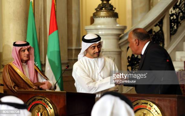 Egyptian Foreign Minister Sameh Shoukry shakes hands with his Emirati counterpart Abdullah bin Zayed AlNahyan as Saudi Foreign Minister Adel alJubeir...