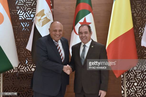 Egyptian Foreign Minister Sameh Shoukry shakes hands with his Algerian counterpart Sabri Boukadoum in Algiers during a ministerial meeting held on...