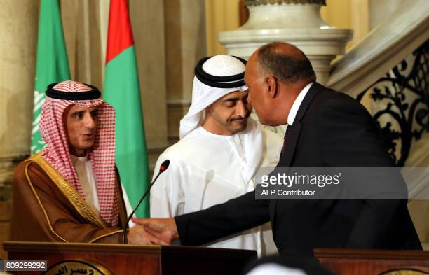 Egyptian Foreign Minister Sameh Shoukry shakes hands with his Saudi counterpart Adel alJubeir as UAE Minister of Foreign Affairs and International...