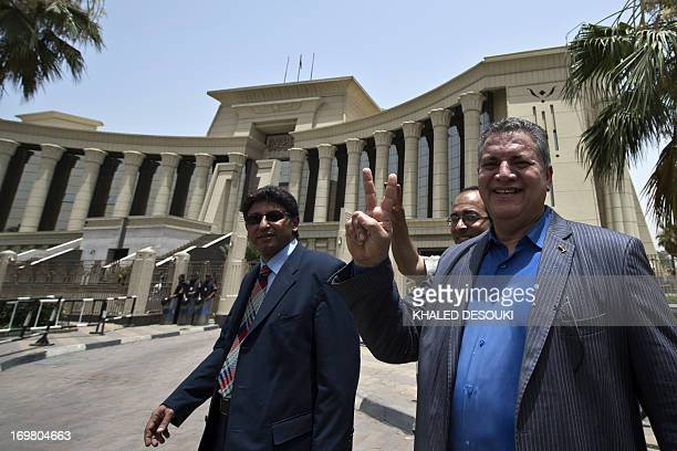 Egyptian former parliament member Hamdi elFakharany flashes the victory sign as he leaves the constitutional court in Cairo on June 2 2013 Egypt's...
