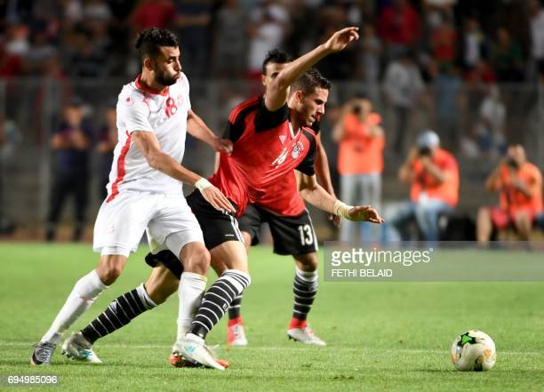 Egyptian forward Sobhi Ramadan Ahmed vies with Tunisian forward Ghalane Chaalali during their African Cup of Nations CAN 2019 preliminary stage...