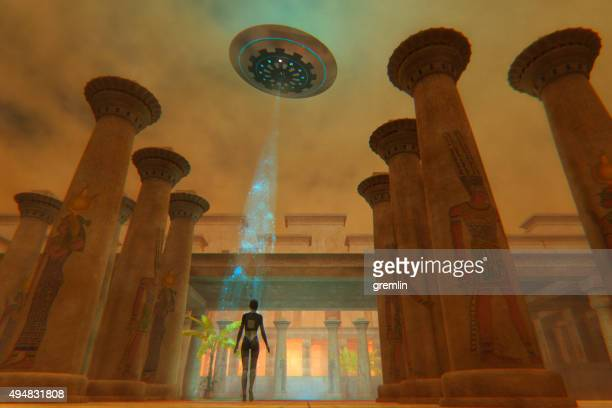 Egyptian goddess in ancient temple and flying UFO