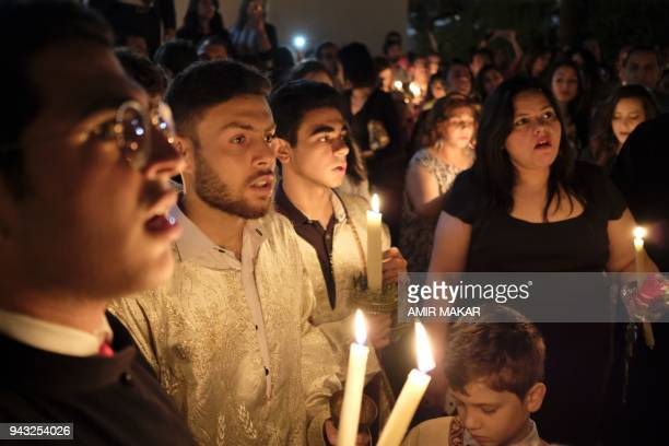 Egyptian Greek Orthodox acolytes and worshippers gather during the midnight Easter Saturday vigil at the Greek Orthodox Church of the Archangels in...