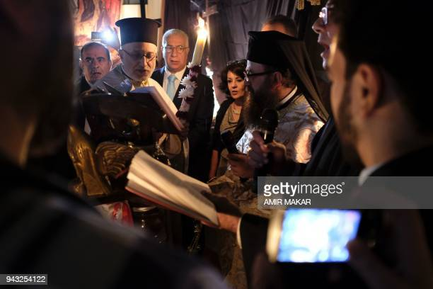 Egyptian Greek Orthodox priests acolytes and worshippers gather to read the liturgy during the midnight Easter Saturday vigil at the Greek Orthodox...