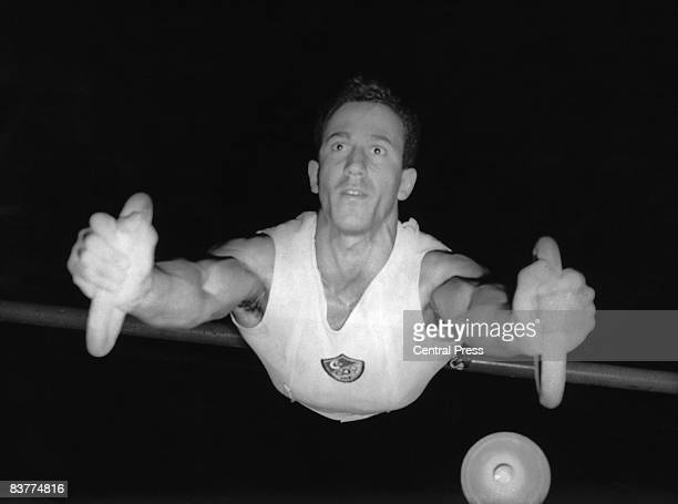 Egyptian gymnast Mohamed Roushdi performs on the rings at the Empress Hall Earl's Court during the London Summer Olympics 12th August 1948