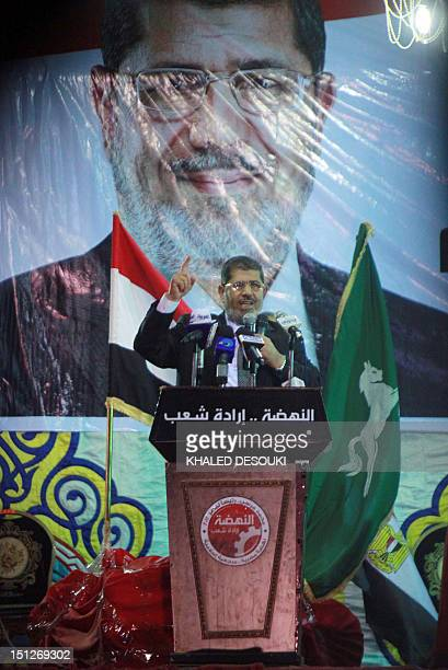 Egyptian head of the Muslim Brotherhood's Freedom and Justice Party and presidential candidate Mohammed Mursi addresses supporters during an election...