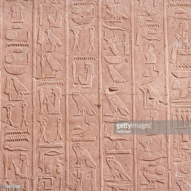 egyptian hieroglyphics in karnak temple near luxor - hieroglyphics stock pictures, royalty-free photos & images