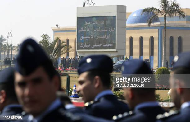 Egyptian honour guards wait as they attend the funeral of former president Hosni Mubarak at Cairo's Field Marshal Hussein Tantawi mosque in the...