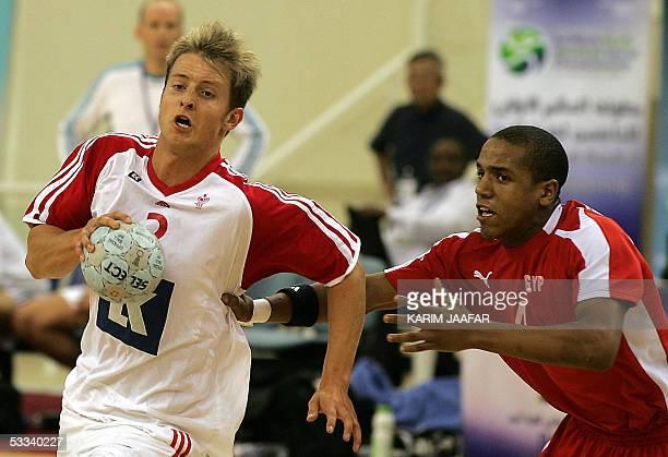 Egyptian Ibrahim Mabruk fights for the ball against Rasmus Bertelsen of Denmark during their match for the First Men's Youth Handball World...