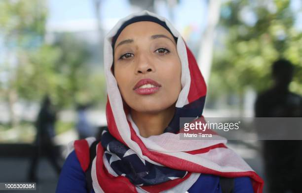 Egyptian immigrant Heba Ramirez poses wearing an American flag hijab before her naturalization ceremony to be sworn in as a US citizen on July 25...