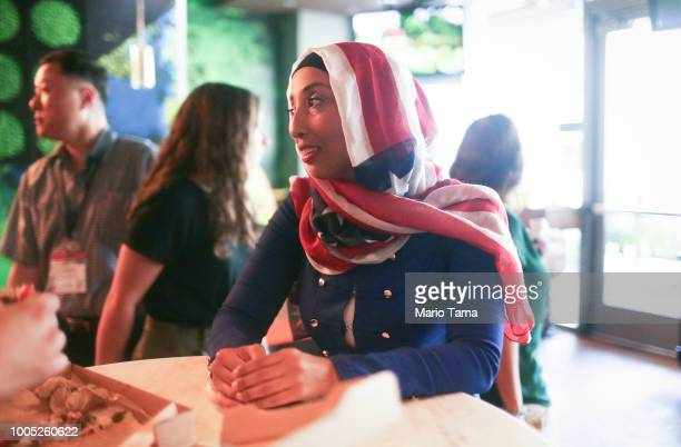 Egyptian immigrant Heba Ramirez wears an American flag hijab while waiting in a restaurant to attend a naturalization ceremony and be sworn in as a...