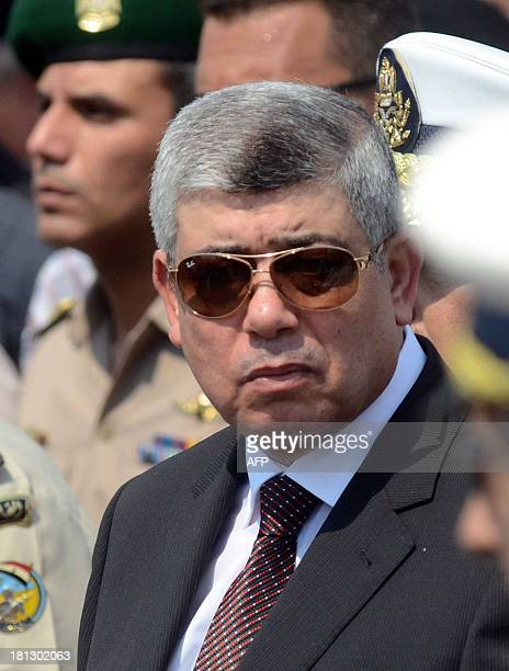 Egyptian Interior Minister Mohammed Ibrahim attends the funeral of Giza security chief Nabil Farrag in the district of Giza on the outskirts of Cairo...