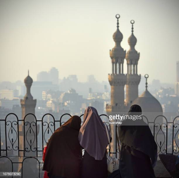 egyptian islamic women - sultan hassan mosque stock pictures, royalty-free photos & images