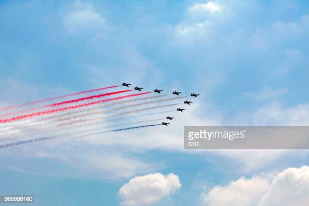 Egyptian jet fighters trail smoke as they fly over the capital Cairo on June 2 during the inauguration of the Egyptian President Abdel Fattah al-Sisi...