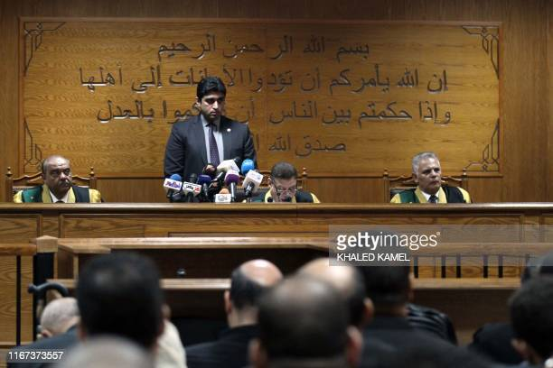 Egyptian judge Mohamed Shirin Fahmi reads out a verdict and sentence as he presides over the retrial of members of the Muslim Brotherhood on charges...