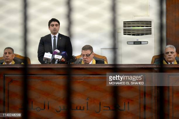 Egyptian judge Mohammed Fahmy reads out the life sentence against Muslim Brotherhood businessman Hassan Malek during the final session of his trial...