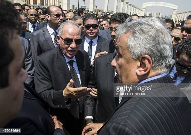Egyptian Justice Minister Ahmed elZend speaks with Lawyers Syndicate Chairman Sameh Ashour during the funeral of Egyptian state prosecutor Hisham...