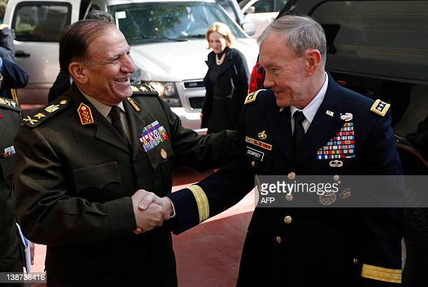 Egyptian Lieutenant General Sami Anan greets US General Martin Dempsey chairman of the Joint Chiefs of Staff upon the latter's arrival for a meeting...