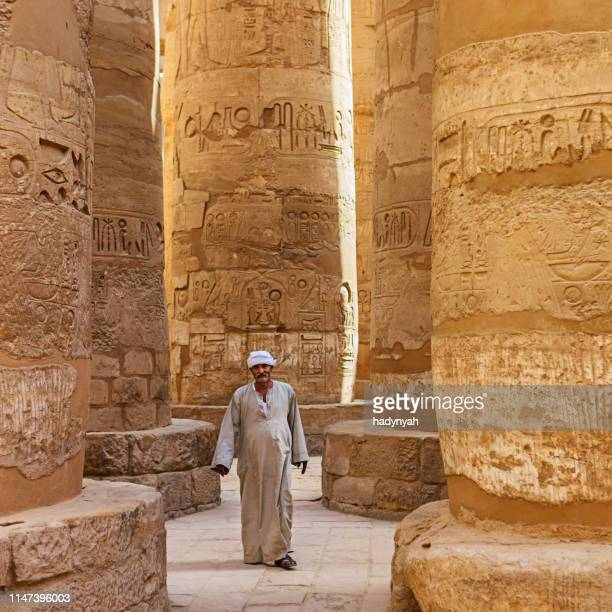 egyptian man in ancient temple, egypt - temples of karnak stock pictures, royalty-free photos & images