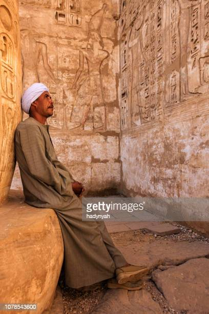 egyptian man resting in ancient temple, egypt - temples of karnak stock pictures, royalty-free photos & images