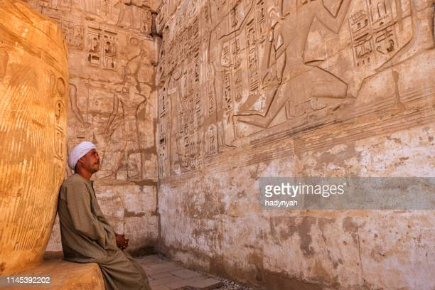 egyptian man resting in ancient temple, egypt - luxor thebes stock pictures, royalty-free photos & images