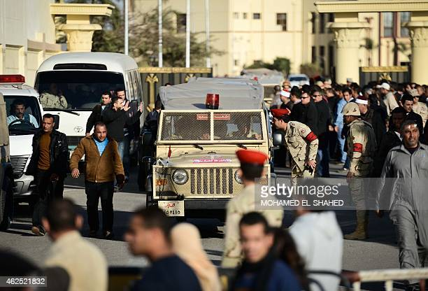 Egyptian members of the armed forces patrol outside alMaza military airport where the bodies of the members of security forces who were killed in...