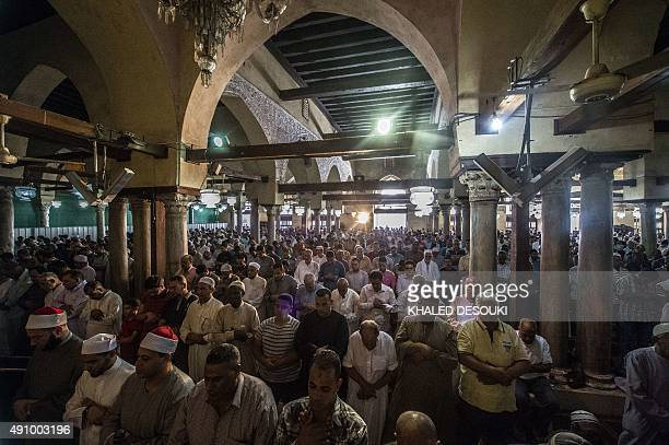 Egyptian men attend the Friday weekly prayer at alAzhar mosque in the capital Cairo's Islamic quarter on October 2 2015 AFP PHOTO / KHALED DESOUKI