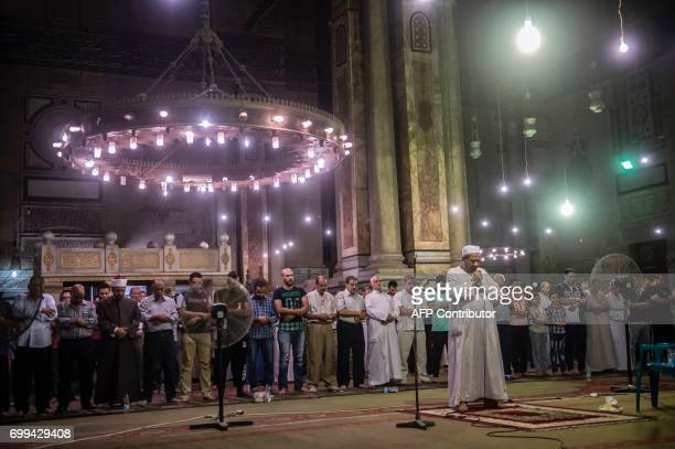 Egyptian men chant the Tarawih recitations on the occasion of Laylat alQadr which falls on the 27th day of the fasting month of Ramadan at Cairo's...