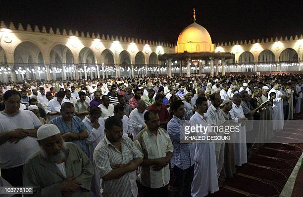 Egyptian men perform the Tarawih overnight prayer during the holy fasting month of Ramadan at Cairo's historic Amr bin alAssi mosque late on...