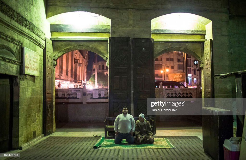Egyptian men pray in the Al-Alzhar mosque on December 17, 2012 in Cairo, Egypt. Yesterday, major human rights and civil society organizations demanded a repeat of the first round of voting which was held on December 15, citing violations such as the lack of full judicial supervision of the vote, Freedom and Justice Party members congregating inside polling stations and Christians being barred from voting at some polling stations.