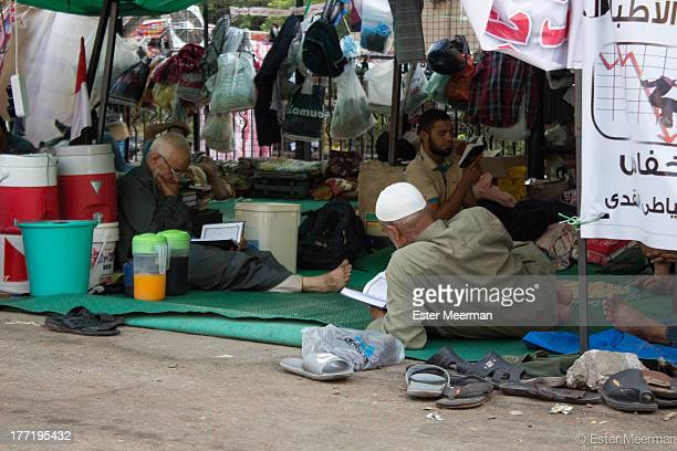 CONTENT] Egyptian men reading the Quran at the proMorsi sitin at the Rabaa Al Adaweyya mosque in the upscale Nasr City suburb in Cairo