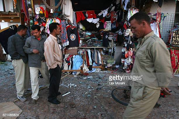 Egyptian men stand at the site where a bomb exploded in the Egyptian resort in the city of Dahab, early Tuesday, April 25, 2006. Three nearly...