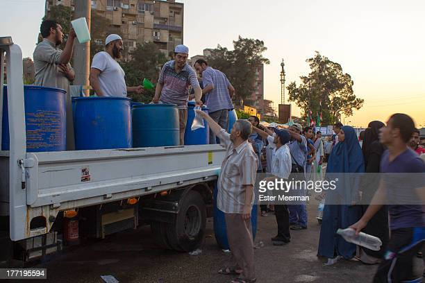 CONTENT] Egyptian men standing in line for water at the proMorsi sitin at the Rabaa Al Adaweyya mosque in the upscale Nasr City suburb in Cairo