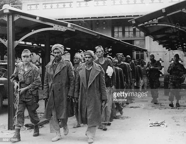 Egyptian men taken prisoner by French soldiers at Port Fuad during the Suez Crisis 10th November 1956