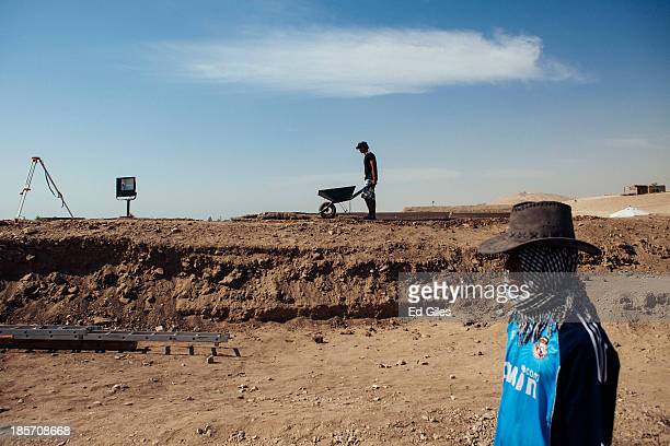Egyptian men work at an archaeological site near the Valley of the Kings on October 24 2013 in Luxor Egypt The site run in partnership by the Academy...