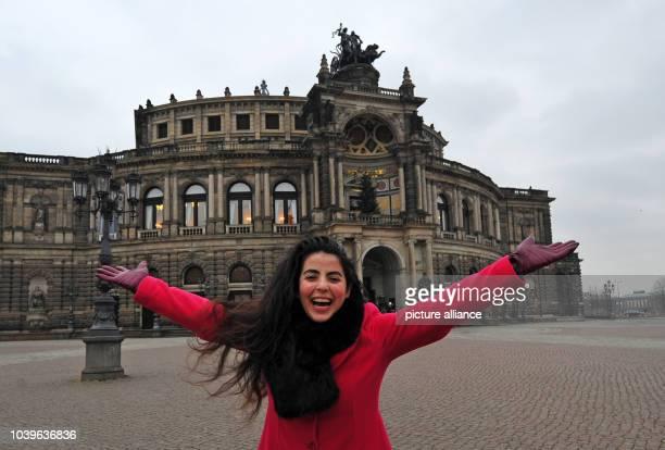 Egyptian mezzo soprano Gala El Hadidi poses in front of the Semper opera house in Dresden, Germany, 01 December 2014. Photo: Matthias Hiekel/dpa |...