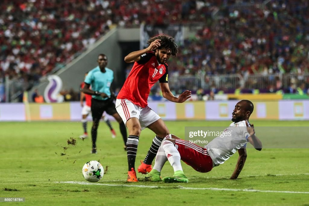 Egyptian midfielder Mohamed Elneny (L) in action during the World Cup 2018 Africa qualifying match between Egypt and Congo at the Borg el-Arab stadium in Alexandria on October 8, 2017. Egypt won 2-1.