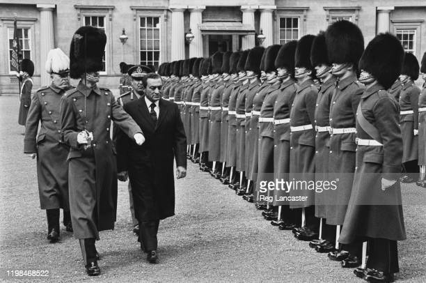Egyptian military and political leader Hosni Mubarak, President of Egypt, walking in front of Foot Guards at Buckingham Palace, London, UK, 15th...