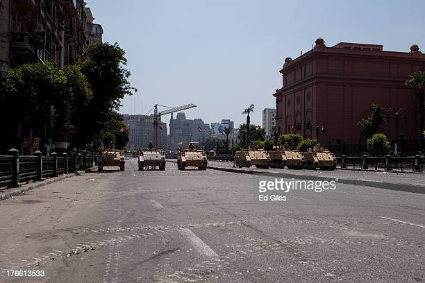 Egyptian military armoured vehicles stand guard at a checkpoint on the edge of Tahrir Square by the Egyptian Museum on August 16, 2013 in Cairo,...