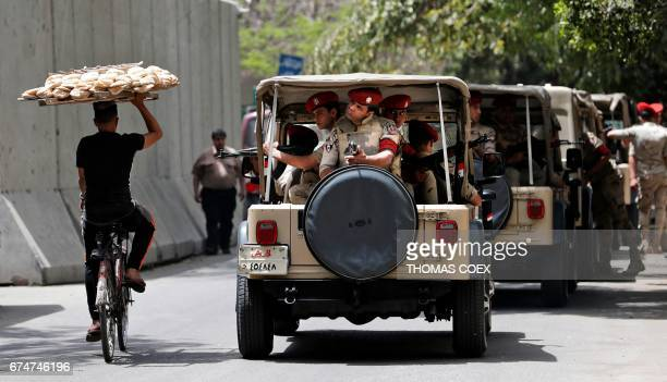 Egyptian military police guard a street near the Vatican's Apostolic Nunciature where Pope Francis stays during his twoday visit in Cairo on April 29...
