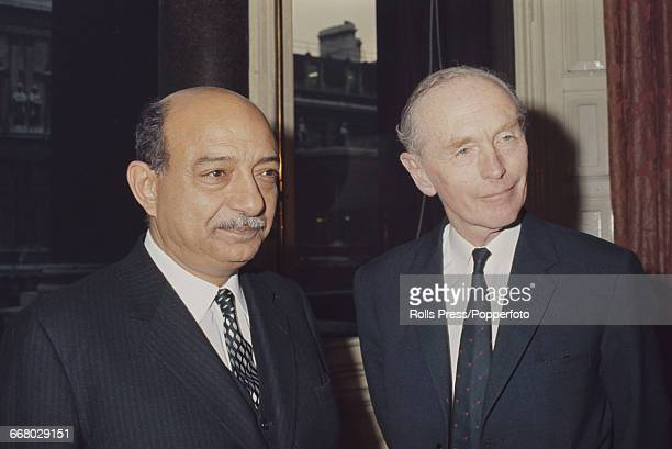 Egyptian Minister of Foreign Affairs Mahmoud Riad pictured left with British Foreign Secretary Alec DouglasHome during meetings at the Foreign Office...