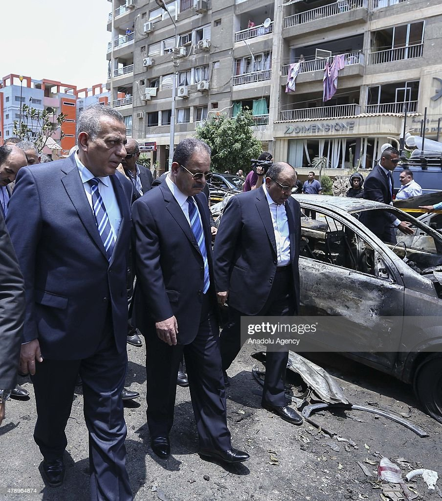 Egyptian Minister of Interior Magdy Abdel Ghaffar (C) inspects the scene of a bombing targeting the convoy of the Egyptian Prosecutor General Hisham Barakat, in a northern suburb of Heliopolis, Cairo, Egypt on 29 June 2015. According to the source, the prosecutor-general sustained moderate injuries and was taken to hospital.