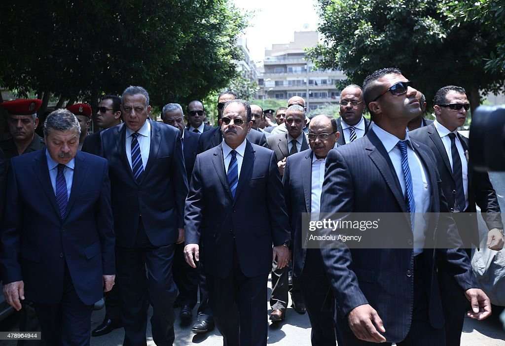Egyptian Minister of Interior Magdy Abdel Ghaffar (C) inspects the scene of a bombing targeting the convoy of the Egyptian Prosecutor General Hisham Barakat, in a northern suburb of Heliopolis, Cairo, Egypt, 29 June 2015 According to the source, the prosecutor-general sustained moderate injuries and was taken to hospital.