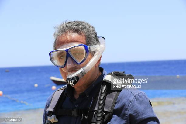 Egyptian Minister of Tourism and Antiquities Khaled alAnani inspects a diving center at the Red Sea resort of Sharm elSheikh on June 20 during a...