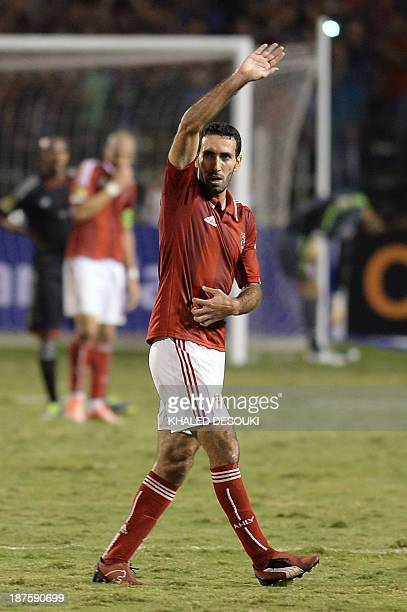 Egyptian Mohamed Aboutreika of alAhly waves to the fans during their African Champions League second leg final match against South Africa's Orlando...