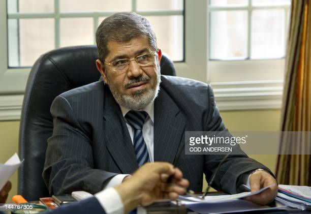 Egyptian Mohammed Mursi, President of the Islamist, Freedom and Justice Party attends a meeting in his office at the party headquarters in Cairo on...
