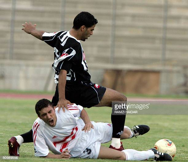 Egyptian Mohammed Sadik of Zamalek fights for the ball against Tunisian Haikal Kammideyh of Sfaxiem during their semifinal match of the Arab Champion...